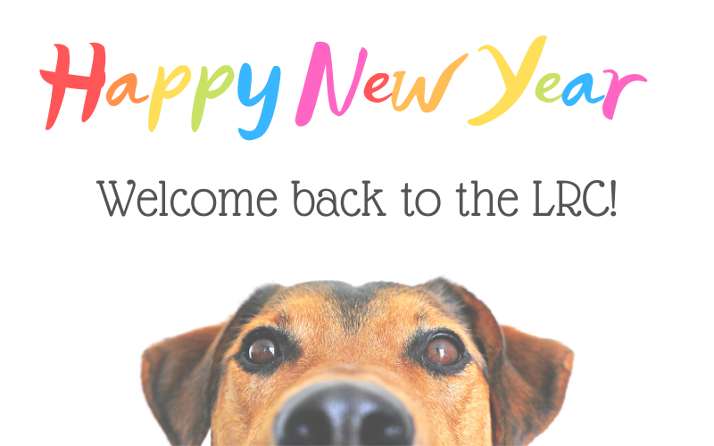 """Image text reads, """"Happy New Year / Welcome back to the LRC!"""" The image has a white background, with the photographed face of a small brown dog peeking up from the bottom of the screen. End description."""