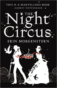 [Image Description: Book cover for The Night Circus. White silhouettes of two figures in Victorian dress with a circus tent behind them, against a black background.]